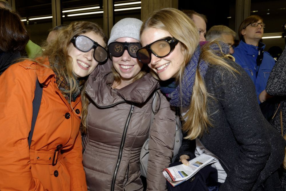 Three girls with protective goggles