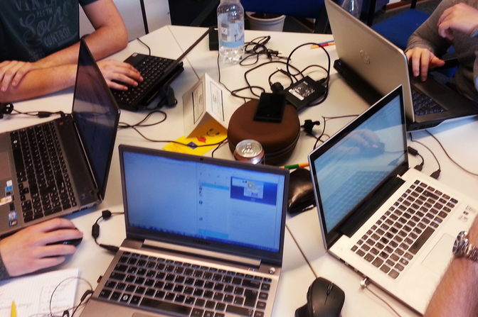 group of people working in front of their laptops