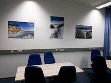 View of a training room with three beach images on the wall
