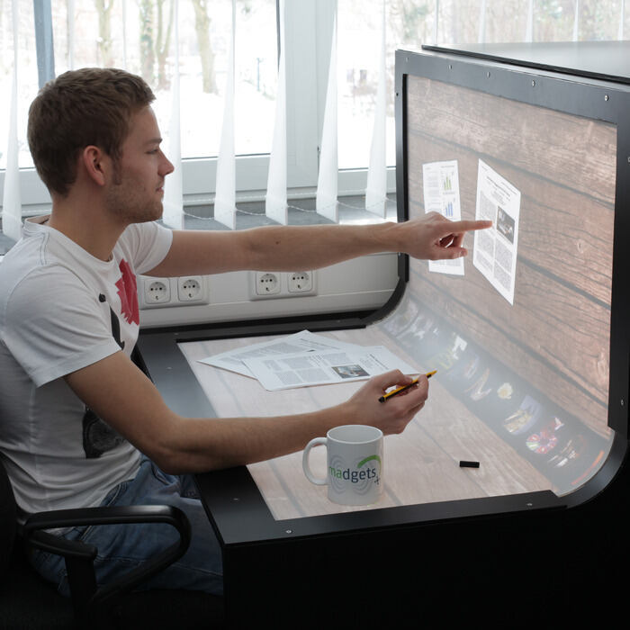 Student in front of a big touchscreen